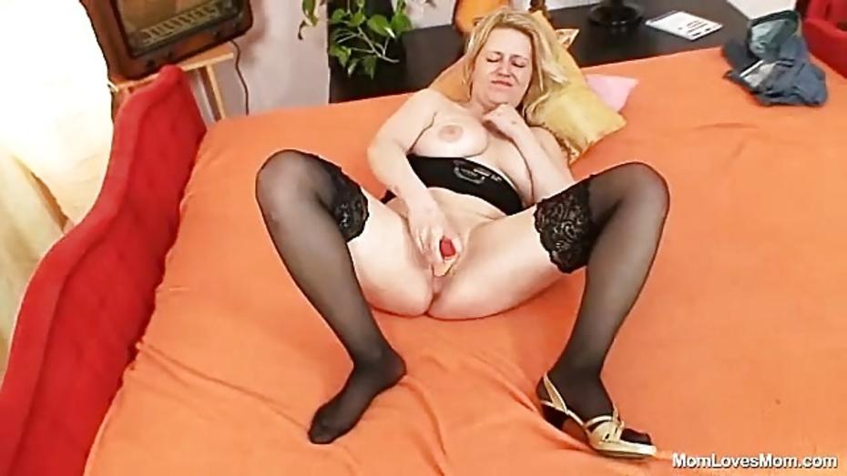Classy grandma pushes dildo up her ass 10