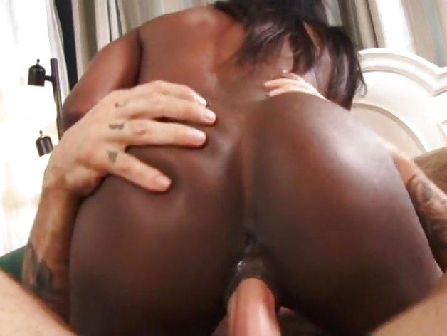 Sensual ebony gives a footjob