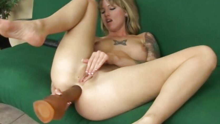 image Tatted up tricia swallowing a thick dildo with her ass