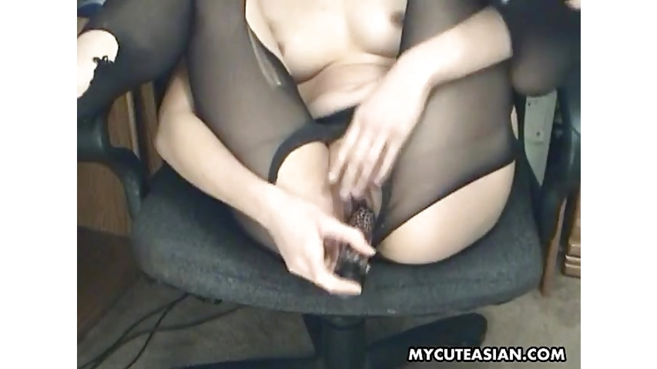 Asian skank cuts her stocking and toy masturb 7