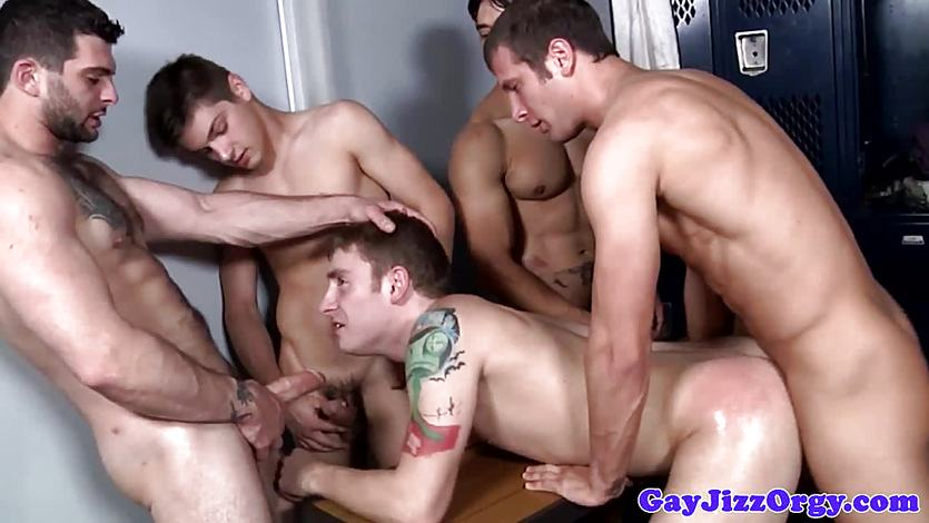 Tattooed jock facialized in group after anal