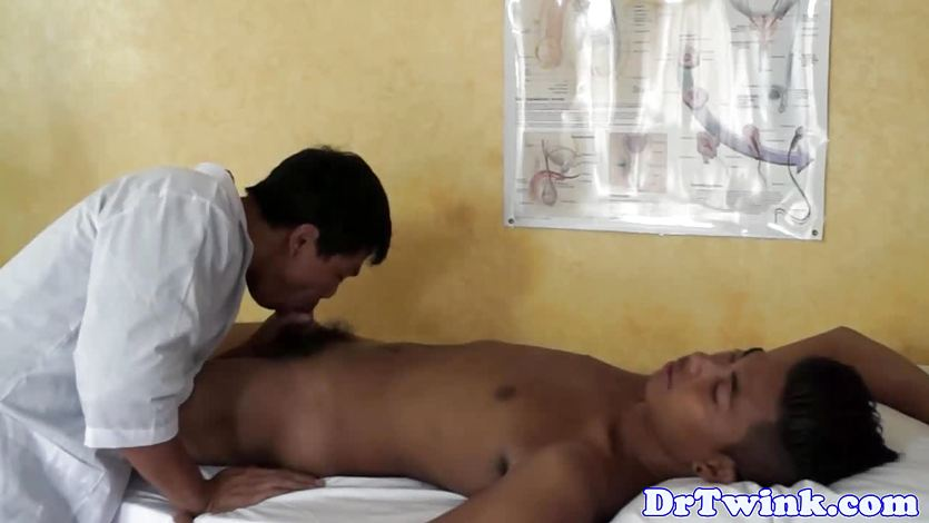 Anal fingered asian twink receives enema