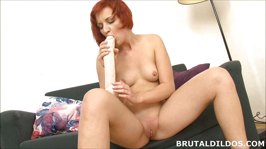 image Strawberry blonde beauty swallowing a big brutal dildo