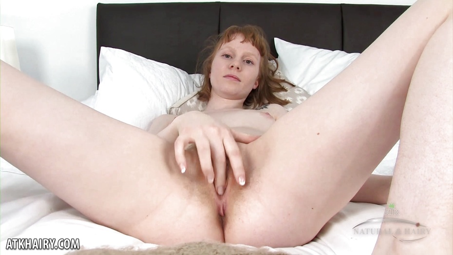 Fellicia slides her dildo deep into her hairy pussy