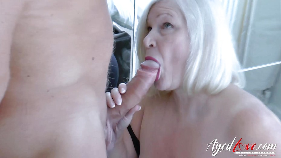Europemature blonde lady is playing on the bed 2
